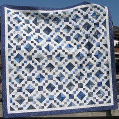 MONOCHROMATIC : Scrappy squares that look to be set on point. I love this interpretation of the Jacob's Ladder block.