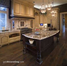 Love the dark wood floor contrast with the light washed cabinets!