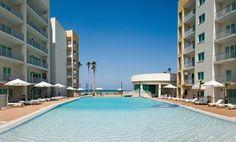 Groupon - 2- or 3-Night Stay at Peninsula Island Resort & Spa in South Padre Island, TX in South Padre Island, TX. Groupon deal price: $109