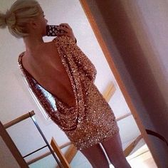 Really sparkly short dress with a really low cut back.