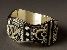 Polymer clay micromosaic bracelet by Cynthia Toops; metalwork by Chuck Domitrovich.