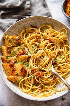 Spaghetti tossed with sun-dried tomatoes, chilli and garlic and served with juicy chicken breasts is a delicious one pan dinner that is a cinch to make!