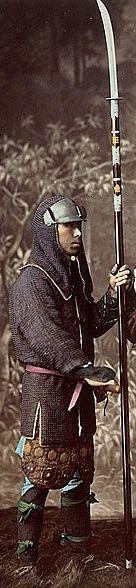 Samurai holding a naginata and wearing a hachi gane (forehead protector) and kusari katabira (chain armor jacket).