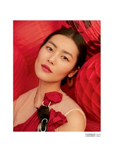 Liu Wen dons red looks for Elle China March 2016 by Mei Yuangui