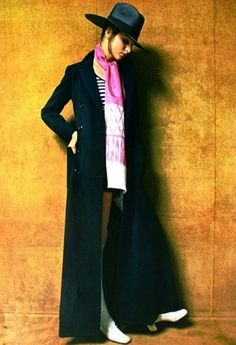 Model wearing a maxi coat designed by Michel Goma for Jean Patou, March 1970.