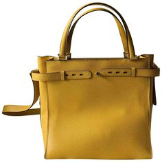 Valextra tote in yellow Epsom leather with shoulder strapExcellent condition with no interior pockets; one with zipperClean and perfect interiors. With dust bagShoulder strap length Yellow Leather, Mellow Yellow, Tote Handbags, Luxury Consignment, Dust Bag, Shoulder Strap, Pockets, Interiors, Lady