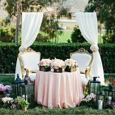Romantic Sweetheart Table. People can stop by to take extra photos w/ the bride and groom. And the wedding party sits nearby, at guest tables with their dates.