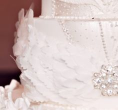 Hundreds of handmade sugar feathers form the Prima Ballerina headdress on a luxury wedding cake