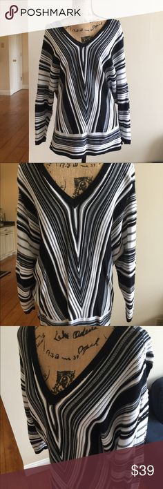 Lane Bryant Top Size 18/20.  Black, white, and gray stripe. Material of top feels like a light sweater. Very business casual. I've worn this once as it was too loose on me. Excellent condition!   Same or next day shipping.  Smoke free home. Lane Bryant Tops