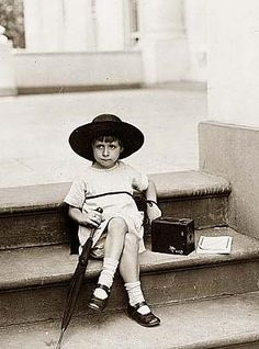 "Here for your perusal is a highly creative photograph of ""Waiting for the President"". It was created in 1922.    The photo illustrates Young girl seated on the White House steps with a camera by her side.    We have compiled this collection of photographs mainly to serve as a valuable educational resource. Contact curator@old-picture.com."