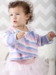 Free Knitting Pattern for Ballerina Wrap Sweater - Long-sleeved wrap cardigan with buttons knit in stockinette with seed stitch. Child's 2 (4, 6, 8). Perfect for self-striping yarn. Designed by Premier Yarns.
