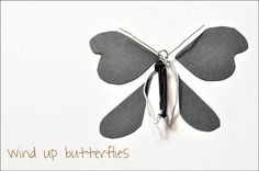 Darkroom and Dearly: {diy: wind up butterflies}... heehee, nephews are going to get a surprise in their camp letters!
