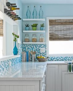 Pretty Blue Tile and Glass Compliments an Airy Kitchen