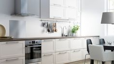 Kitchen with GRYTNÄS off-white drawer fronts and doors