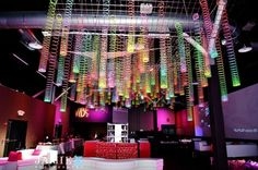 Slinky chandeliers hung from the ceiling - great for an 80's themed party!  Send them home with guests as favors at the end of the night.