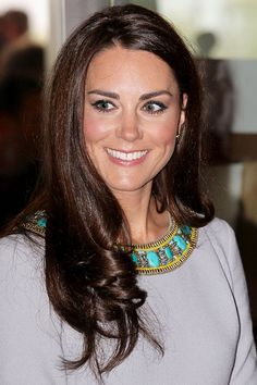 Kate has the perfect head of hair at the royal premiere of African Cats in London, April 25, 2012. Keeping the glossy chestnut lengths sleek and smooth, the ends are expertly teased into tumbling Ava Gardner-esque ringlets.