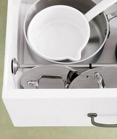 Use a Tension Rod: To keep pot lids from rattling around and getting lost in kitchen drawers, position a short tension rod to create a divider. Stack pots and pans in the larger section and lean lids against the rod on the smaller side.