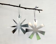 Simple ornament made from metal hung on a branch.