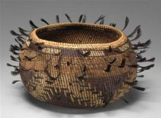 Basket with feathers  -  Pomo, California  -  Early 20th century
