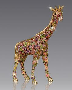 """Handcrafted giraffe figure. Metal. Hand enameled and hand set with Swarovski crystals. 6.25""""W x 2.5""""D x 9.75""""T. Made in the USA."""