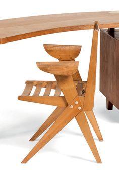 PIERRE JEANNERET (1896-1967) Fauteuil Frêne Vers 1948 H_80,5 cm L_62,5 cm P_54 cm Bibliographie: Le décor d'aujourd'hui, revue de décoration, N°83, 1953