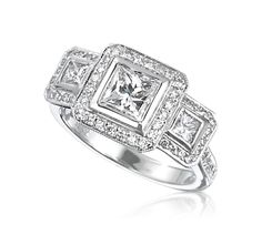 Possible reset for my 3 stone ring?  The two side stones would be my princess cut rubies.