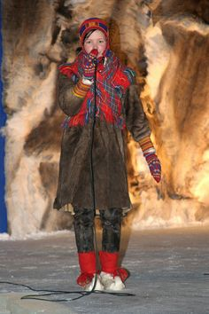 Saami girl performs a joik at the opening of the 400th Jokkmokk Winter Market. Sweden. Size to A4: Sami, Jokkmokk Market: Arctic & Antarctic photographs, pictures & images from Bryan & Cherry Alexander Photography.