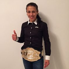 adorable Polish Champ Joanna Jedrzejczyk proudly wearing her belt : if you love #MMA, you'll love the #UFC & #MixedMartialArts inspired fashion at CageCult: http://cagecult.com/mma