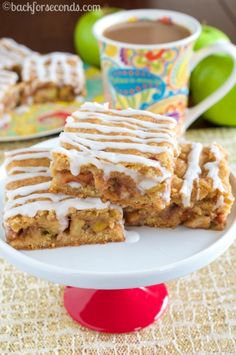 Snickerdoodle Apple Pie Bars ~ soft and chewy snickerdoodle bars, filled with a layer of warm cinnamon apples, and topped with a drizzle of sweet glaze… INCREDIBLE!