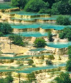 Huanglong Pools, China. This area is known for its colorful pools formed by calcite deposits, especially in Huanglonggou (Yellow Dragon Gully), as well as diverse forest ecosystems, snow-capped peaks, waterfalls and hot springs. Credit: Rema Chhakchhuak