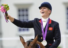 Zara Phillips looks delighted as the crowd roar their approval as she rides off