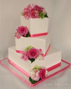 Off Set tiers with fresh flowers.  I stenciled the cake, but it is difficult to see.