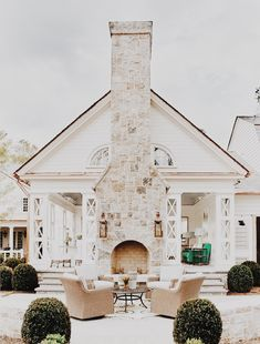 I mean, what's not to love... stone fireplace, exterior in white, creamy neutrals, green landscaping