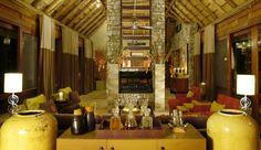 Morukuru: A timber ceiling, expansive windows and a central fireplace mark the Lodge living room.  South Africa