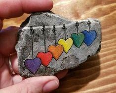 String of hearts love token / hand painted stone / hand painted rock / unique painted rock / unique heart rock art / gift for heart lover Rock Painting Patterns, Rock Painting Ideas Easy, Rock Painting Designs, Pebble Painting, Pebble Art, Stone Painting, Stone Crafts, Rock Crafts, Arts And Crafts