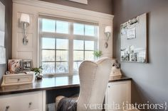 Lovely trim work around window to make the area feel more grand. Great idea to flank window with lighting. Beautiful wingback chair