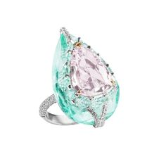 The two main stones in this one-of-a-kind ring are mounted using Boghossian's Kissing Diamonds techniques, which makes stones appear to hover above each other. Compilation: 5.02-carat Fancy light purplish pink, pear-shape diamond; 30.09-carat pear-shape beryl; 14 cushion-shape light green diamonds weighing 3.00 carats; 1.58 carats of small brilliant-cut diamonds. Set in 18-carat white gold. Made in Geneva by Boghossian.
