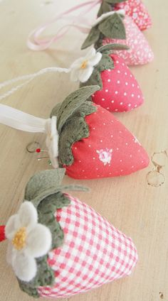 "pretty pin cushion strawberries.  Pretty by Hand fills her's [I do, too!] with walnut shells i.e. ""lizard litter"" from the pet store.  ***I always always always line mine with white fabric to keep their colors bright and the oils/dust out of the outside fabric.  I <3 the weight!"