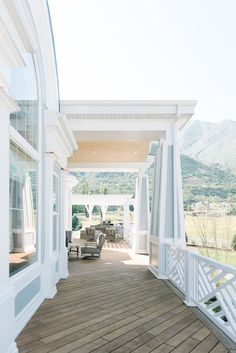 Stunning porch area with crisp white with turquoise blue accents. Isn't it so pretty? #Porches