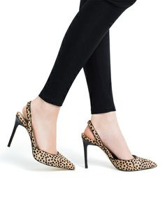 Karla - Sophisticated slingback pump with a fun look.