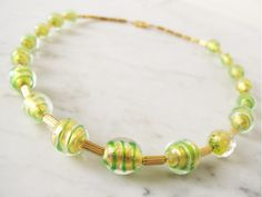 Vintage murano beads: gold and green