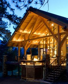 An outdoor area, sheltered by a timber-frame roof, marries indoor and outdoor spaces and provides the perfect spot for the Tiffins to relax or entertain.