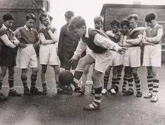 Skillful footwork at after-school football training, 1957, National Media Museum, Bradford / SSPL © Daily Herald / Fox Photos