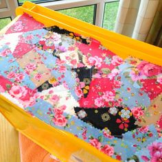 My material box looked a bit mundane so I decided to découpage some odd bits of bunting fabric.