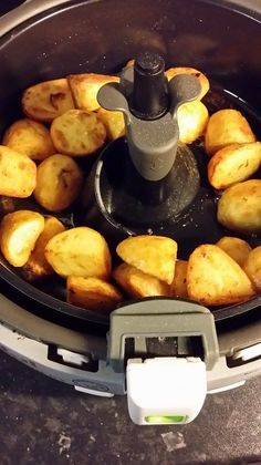roast potatoes in tefal actifry - not as good as traditional roasties but quick, easy and heathy!