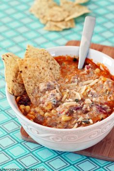 Love enchiladas? Make this Mexican recipe  in the slow cooker with this hot and hearty crockpot beef and rice enchilada soup recipe.