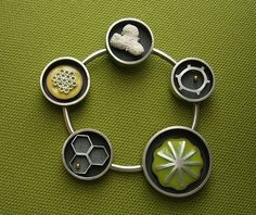 """Janice HO: 'not an actual life cycle'  silver, copper, 24k, enamel, coral  2.5 x 2.5 x .25"""""""
