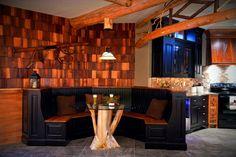 Beautiful bench seating in Adirondack style basement kitchen, reminiscent of a cozy lodge. #ownalandmark