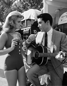 ladiesofthe60s:  Ann-Margret and Elvis Presley rehearse the duet they are to sing in the film Viva Las Vegas photographed in 1963.