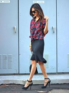 Button down with fit and flare skirt. Knot at the waist shows off the silhouette of the skirt